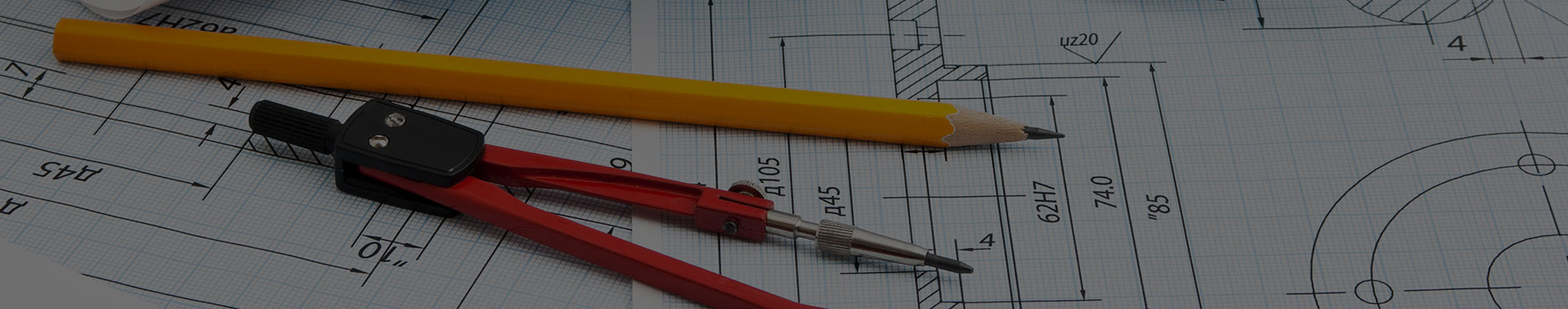 pencil and compass resting on building plans