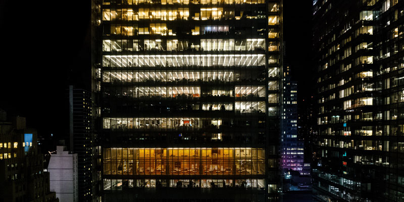 exterior of offices in skyscraper building at night