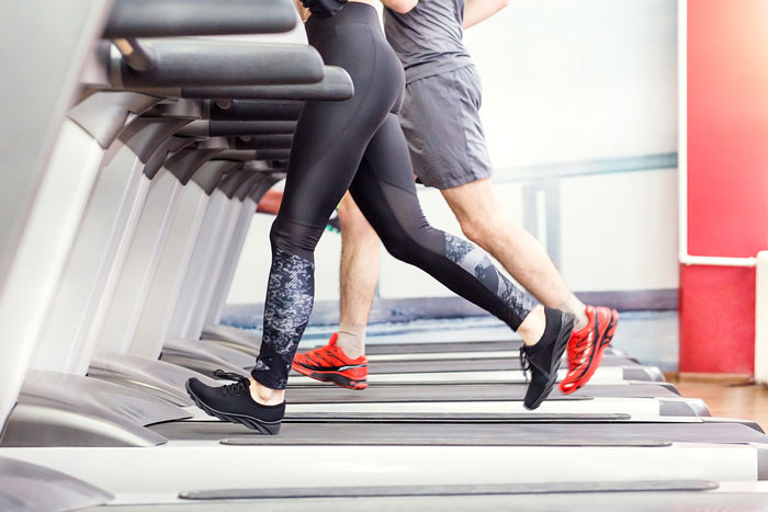 runners on a treadmill with hvac controls
